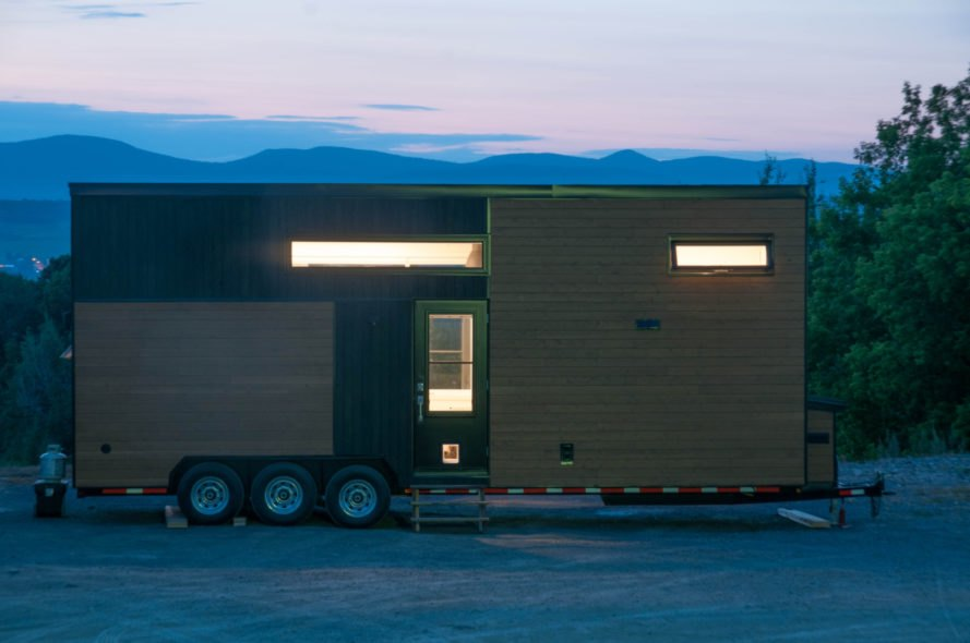 cedar-clad tiny home in evening time