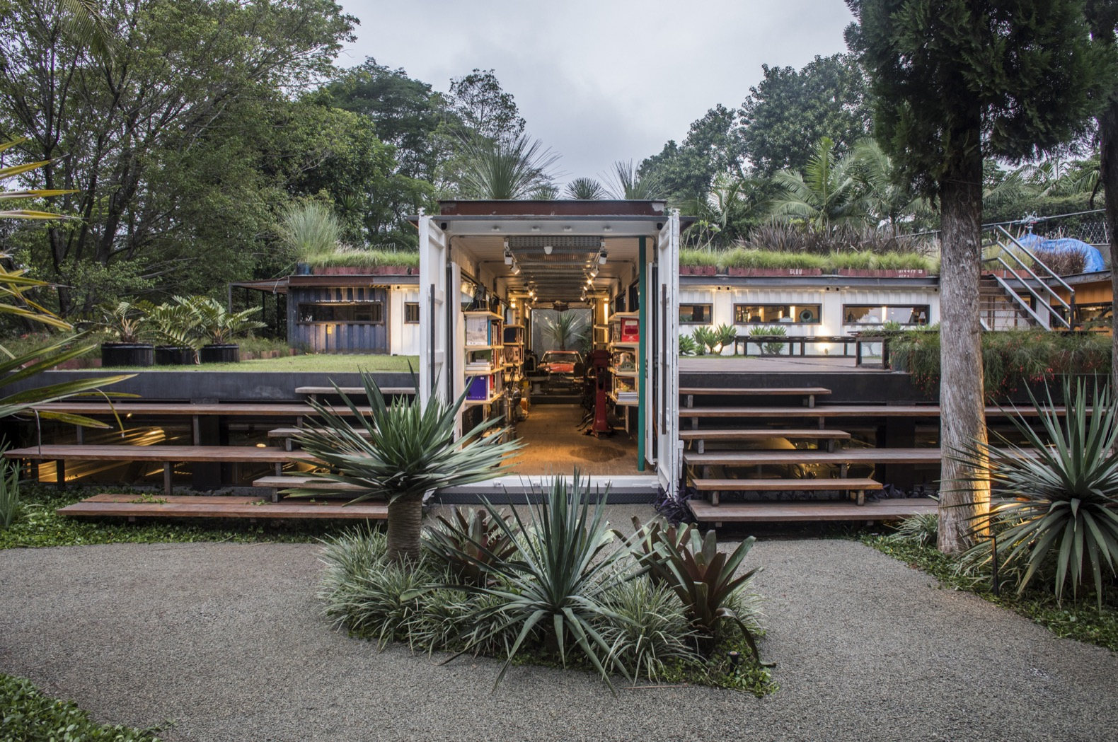 Shipping containers become a spectacular plant-covered gallery