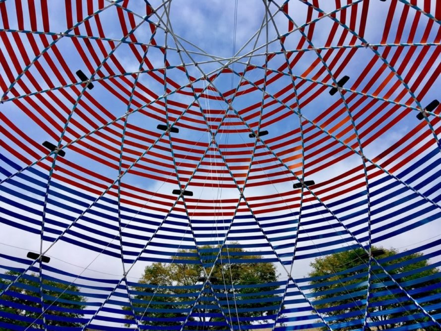 dome made with red and blue seatbelts and rearview mirrors