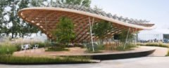 cropped close-up of pavilion with curved roof and lots of plants