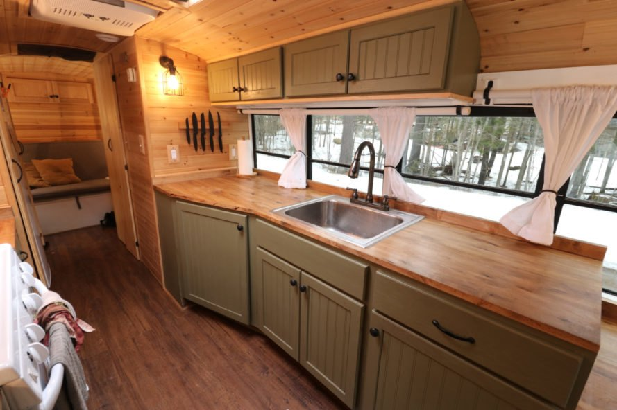 kitchen with wood counters and light green cabinets