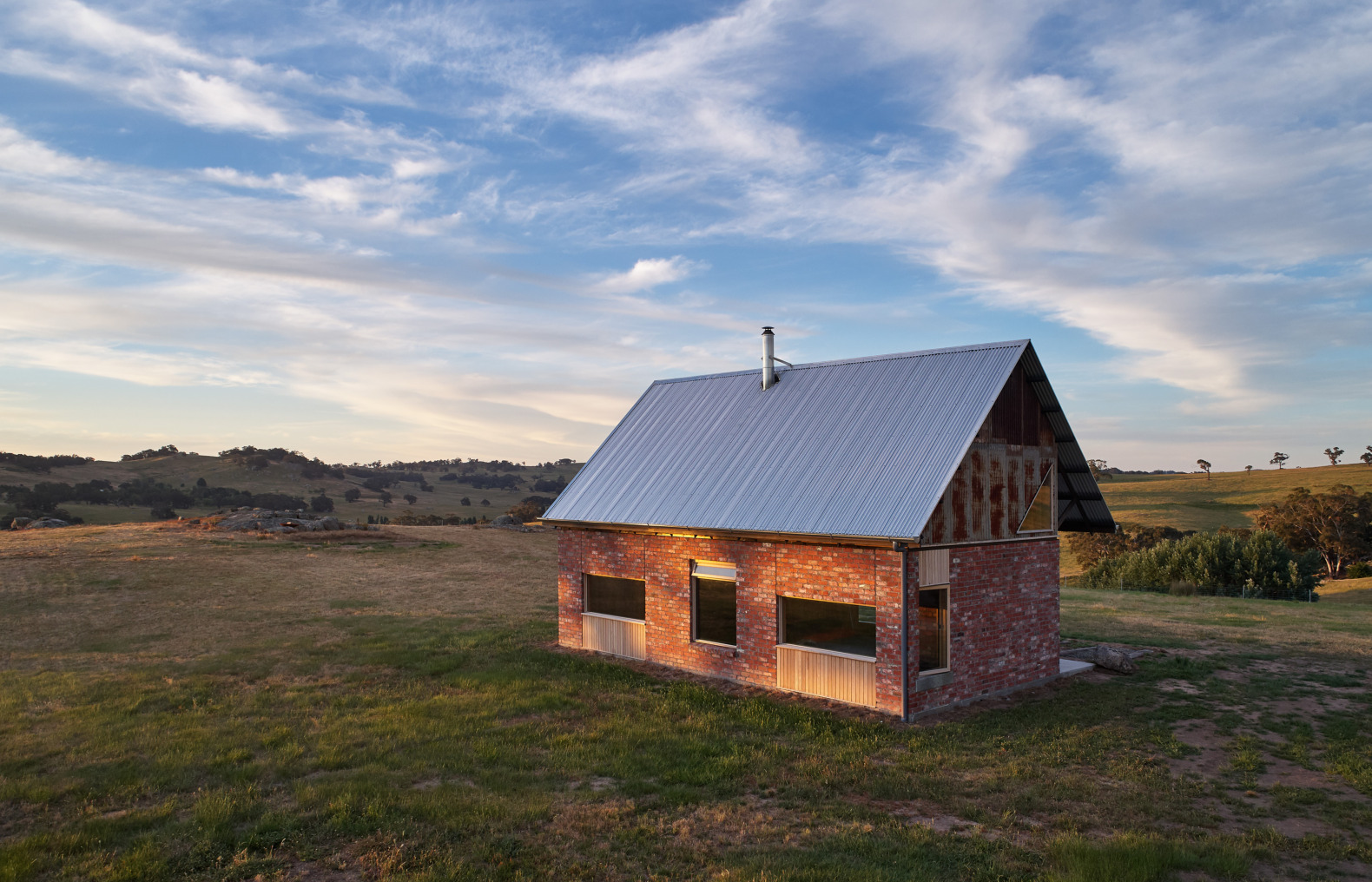 A tiny, rustic, off-grid cabin sits on vast 300 acres in Australia