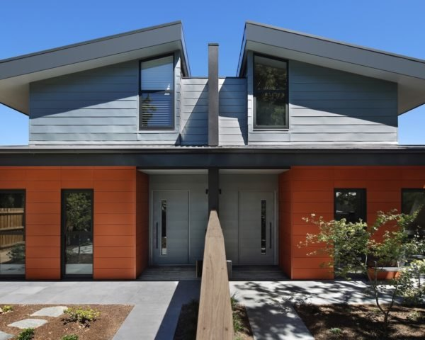 home with split roofline and terracotta siding