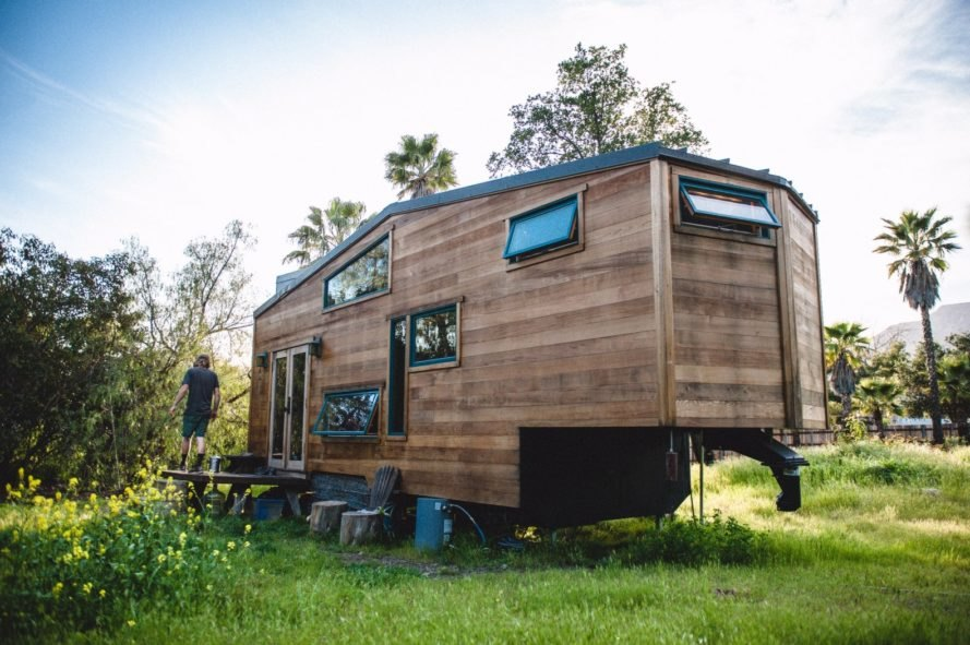 wooden tiny home with windows