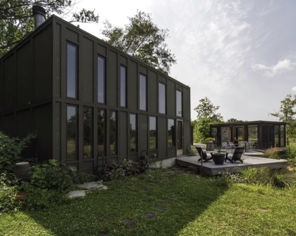 black cube home with gray patio