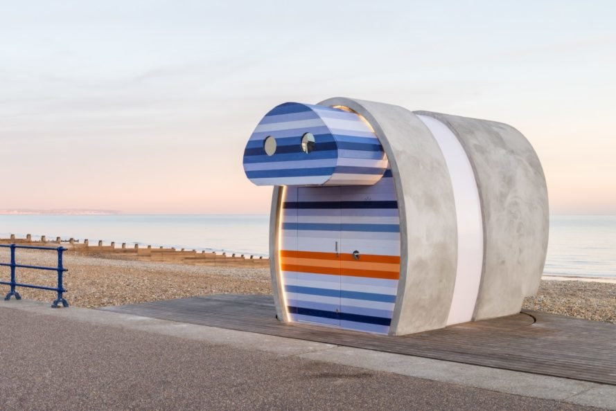 angled view of beach hut with binocular-like shape