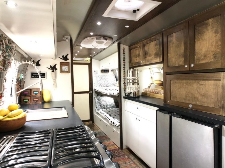a kitchen and living space inside a renovated airstream