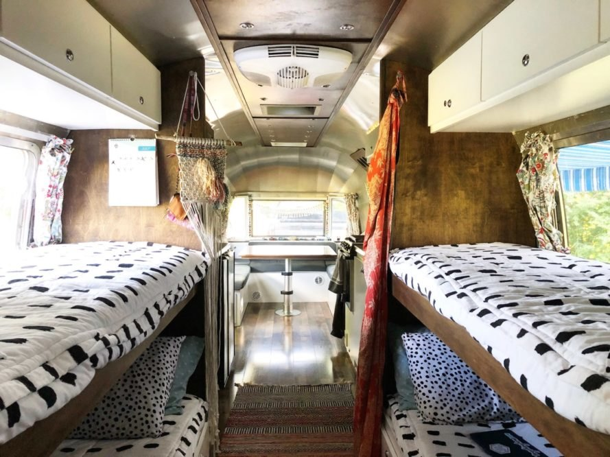 interior of renovated airstream with four beds