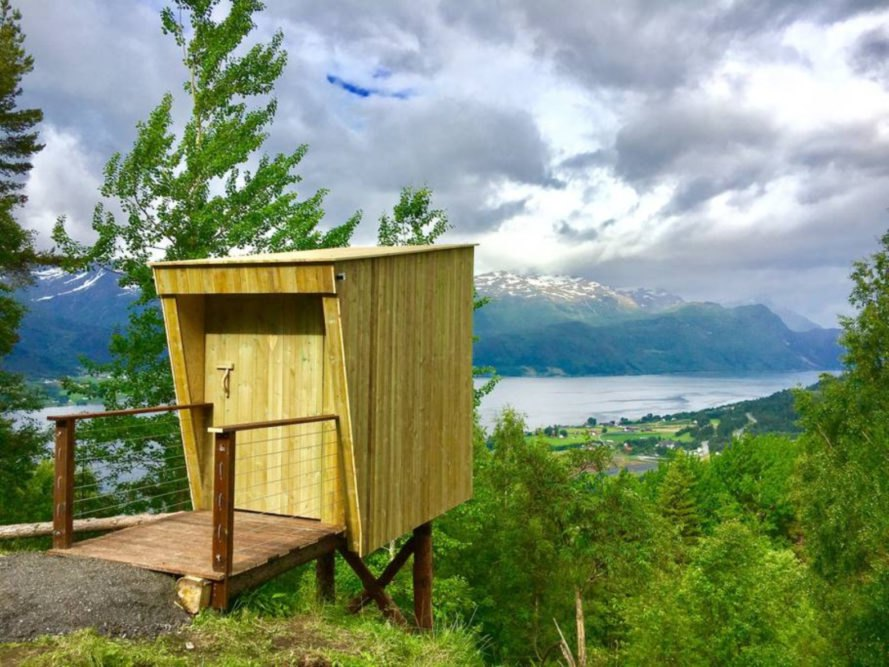 tiny wood structure overlooking views of the mountains