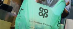 green compostable bag with Co-op logo on it
