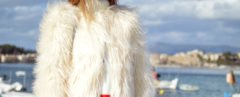 cropped close-up of woman near water wearing white fur coat