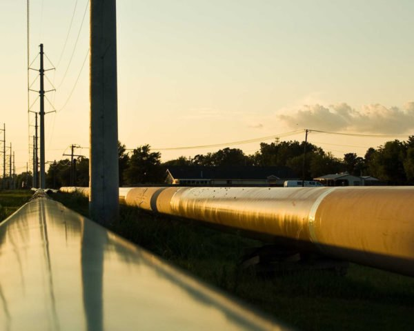 Pipeline trailing off into distance at sunset