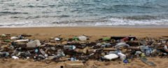 cropped close-up of heaps of trash on a beach