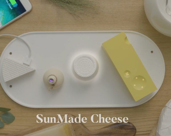 cheese-shaped chargers and accessories on a white, solar-powered plate