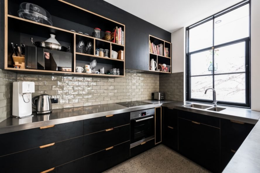 kitchen with black cabinets and gray countertops