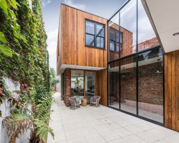 timber home with walls of glass in the middle
