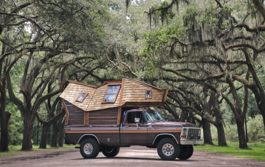 truck with tiny wooden cabin on the truck bed