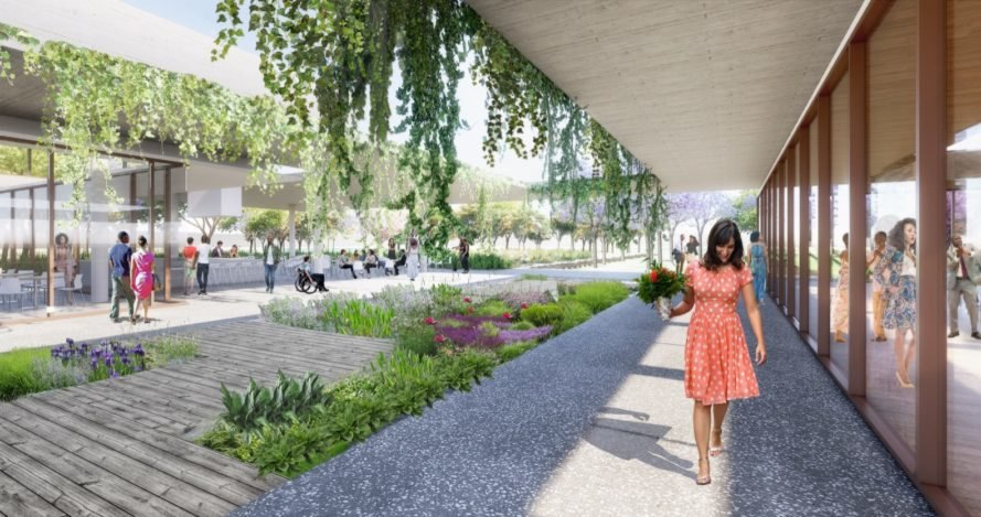 rendering of white and glass buildings with draping green roofs