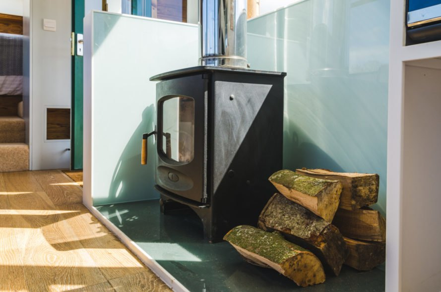 a wood-burning stove with firewood