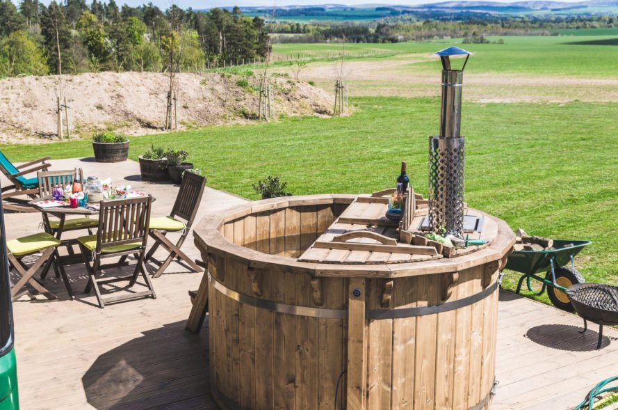 wooden hot tub on outdoor deck