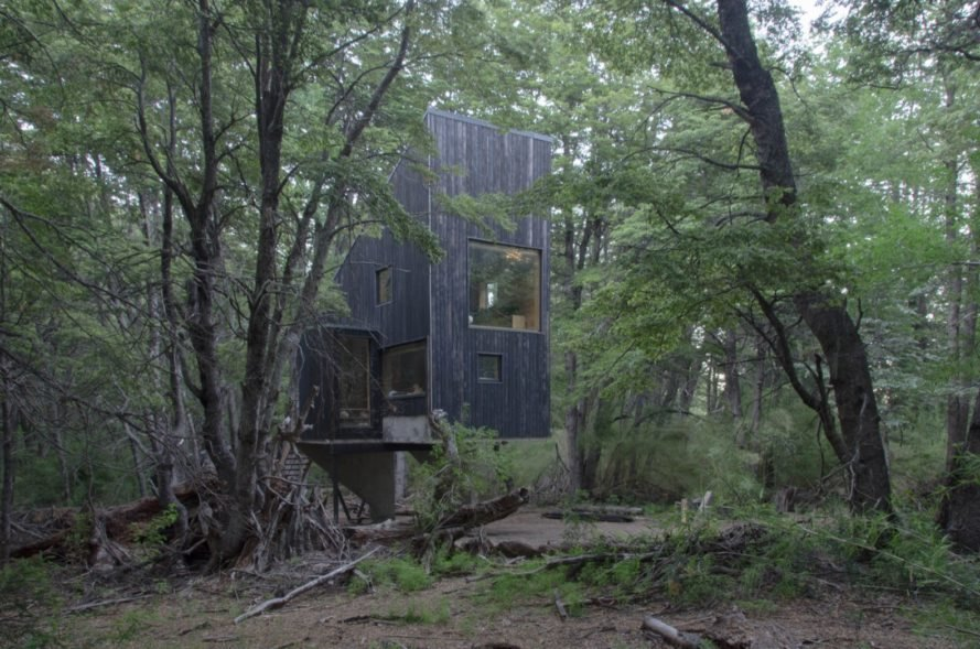 Angular Timber Cabin Is Hidden Inside An Ancient Mountain