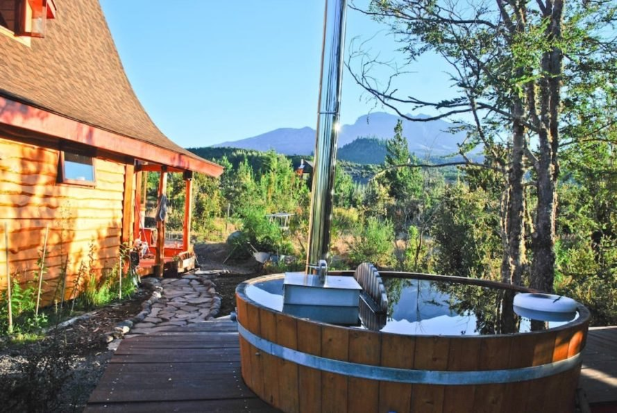 wood-fired hot tub with mountains in background