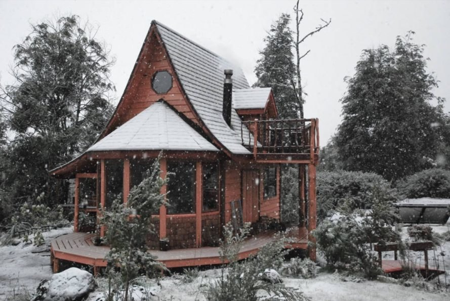 timber cabin in snowy landscape