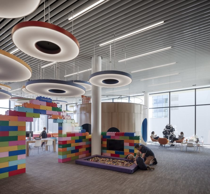 room with colorful lights and large lego bricks