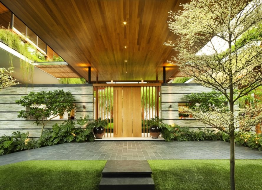 wooden door on home surrounded by greenery