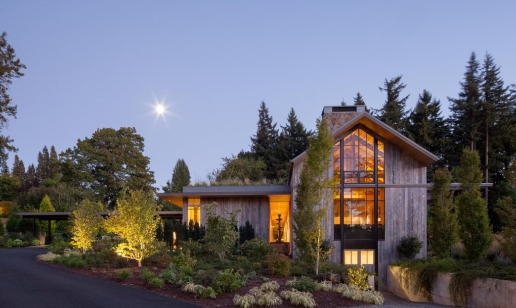 This green-roofed home for a master gardener embraces nature