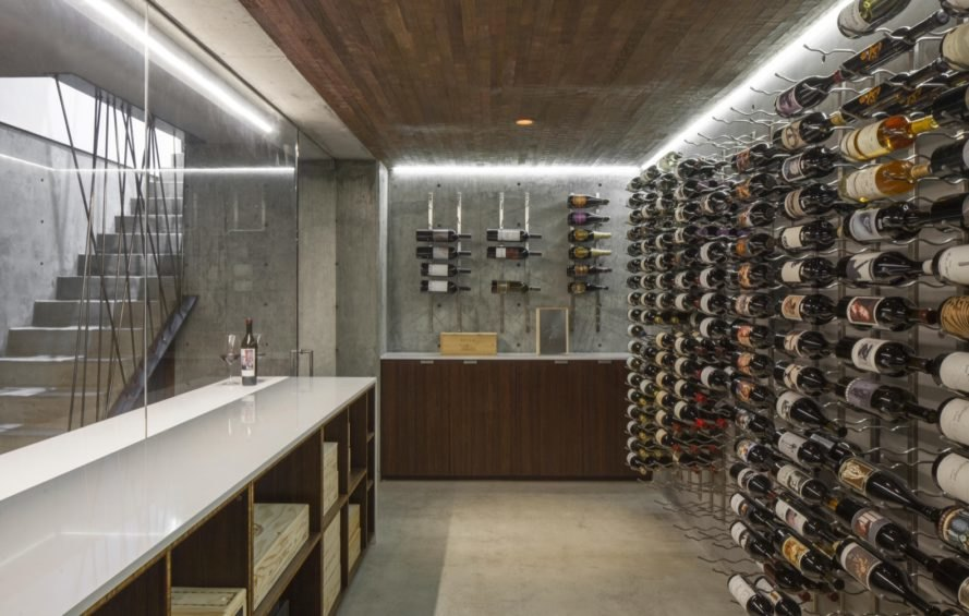 wine cellar with wall of wine bottles