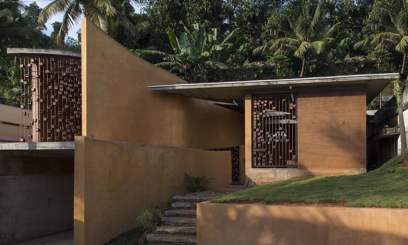 This rammed earth home in India uses recycled materials throughout