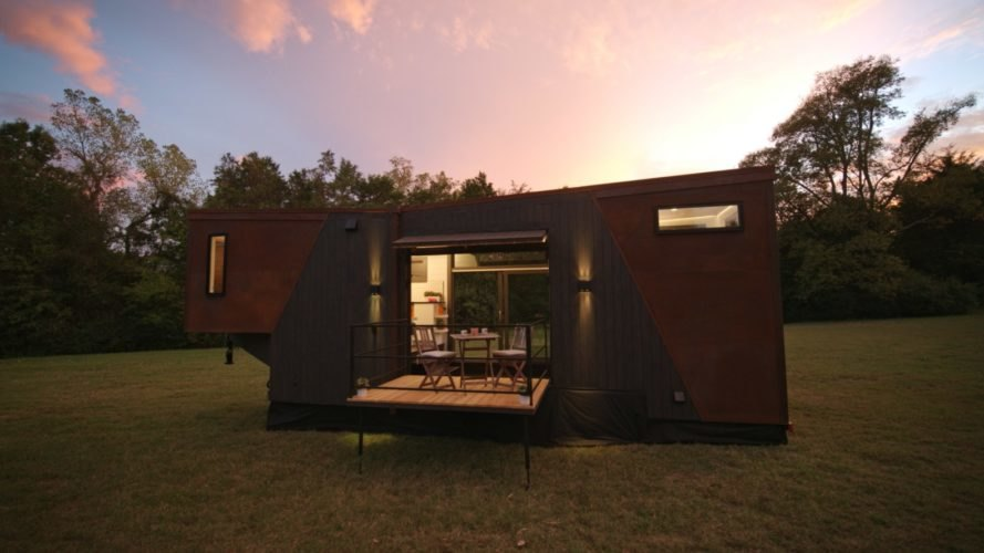 a tiny home with dark wood and black cladding