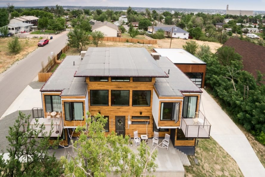aerial shot of shipping container home with wood facade