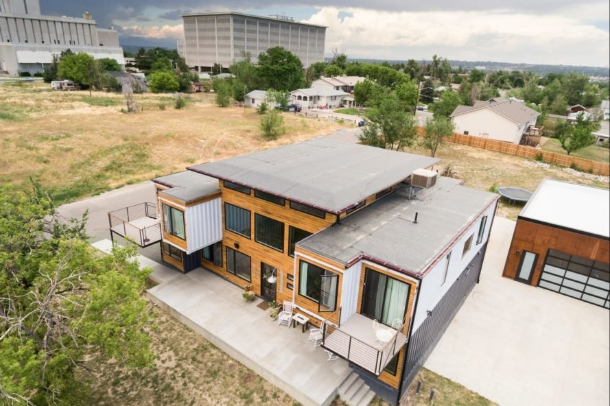 aerial shot of black, white and wood shipping container home