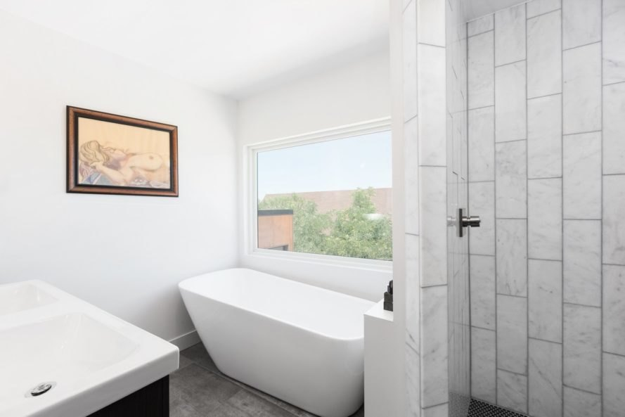 all white bathroom with large window