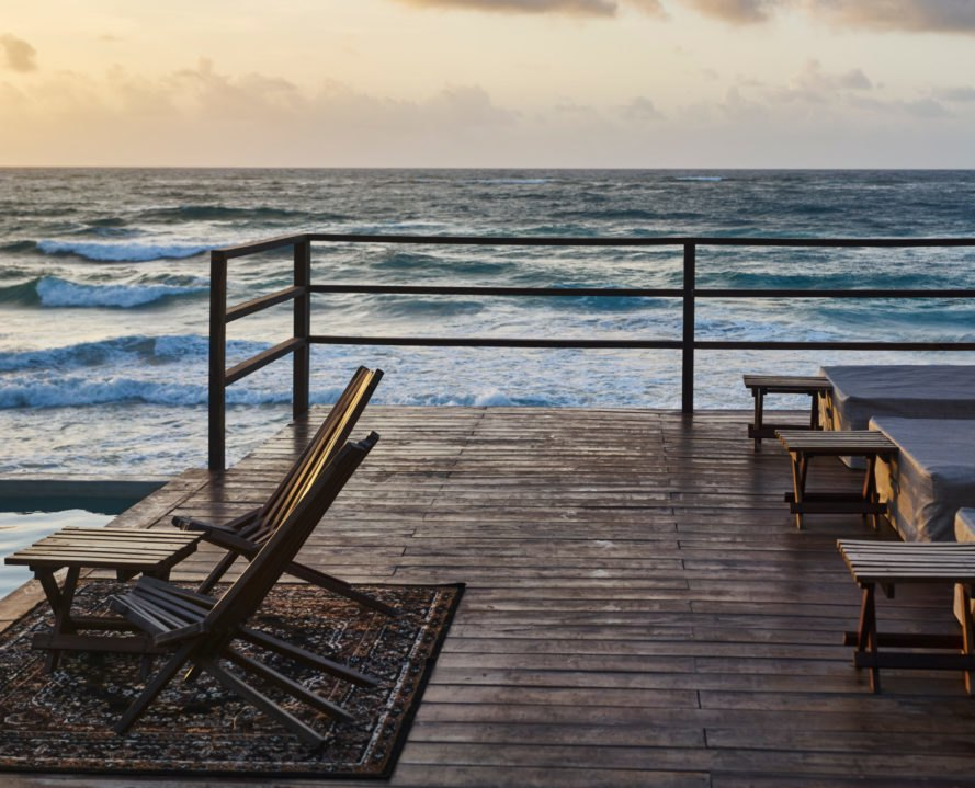 wooden deck overlooking sea