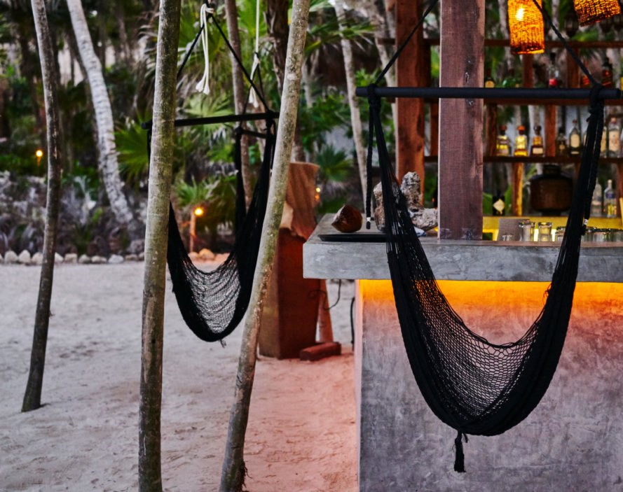 hammocks hanging next to a bar