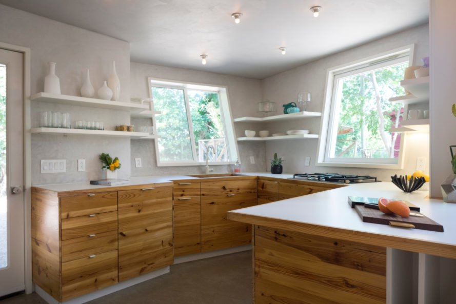 kitchen with wooden cabinets and white walls