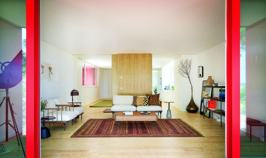 living room clad in wood panels and white walls