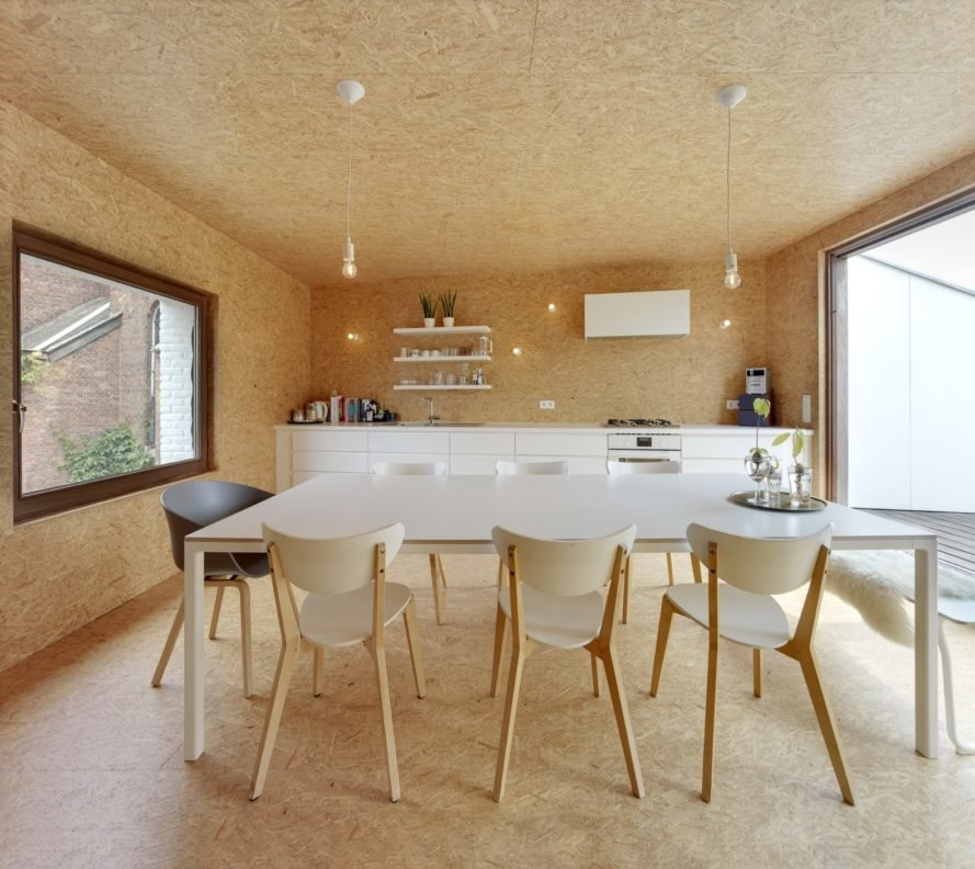 wood room with white dining table and white kitchen cabinets