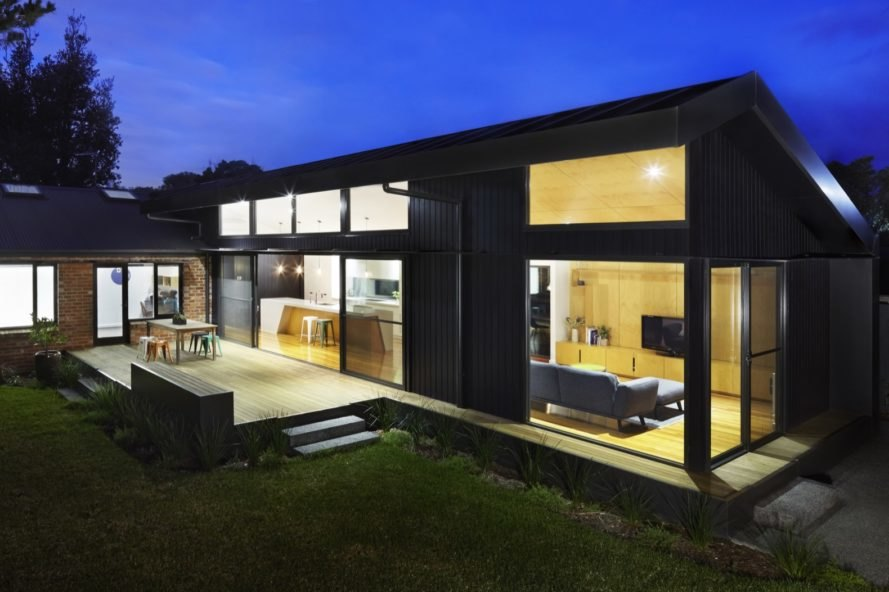 black timber extension of a brick mid-century home