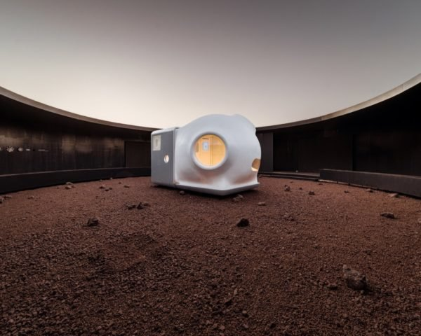 rendering of white pod-like home on Mars