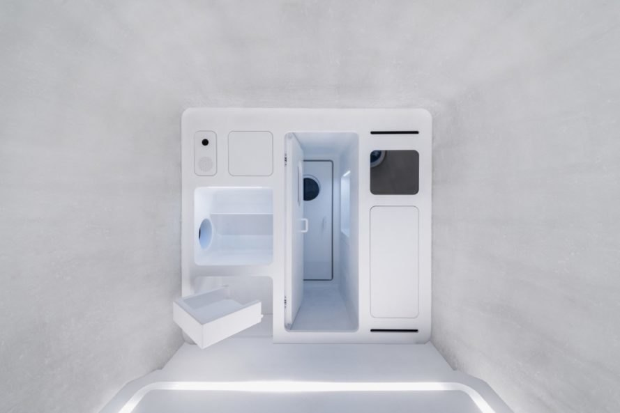all-white room with door leading to all-white hallway