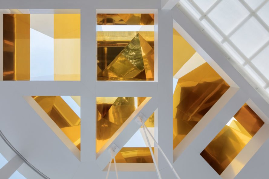 geometric white frame filled with gold cladding