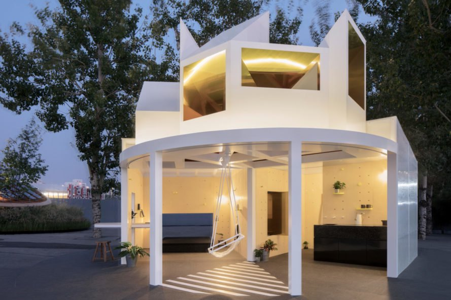 white building with exposed living spaces with no walls