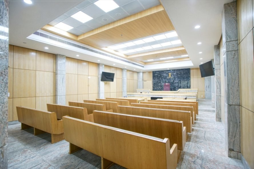 courtroom with skylights and wood benches