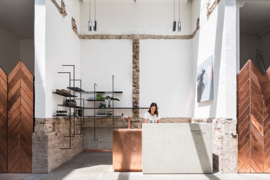 woman working at concrete and copper desk