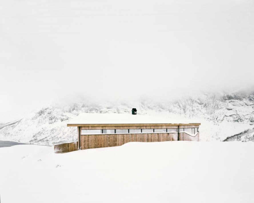 wooden cabin on snowy hill