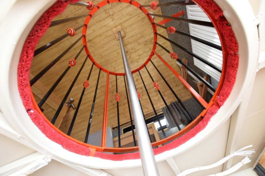 view from below of a fire pole